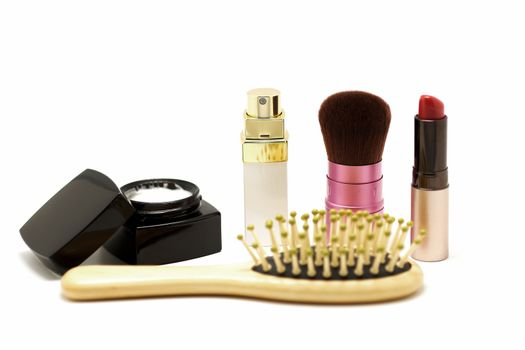 cosmetic set with parfume blusher brush lipstic and comb on whit