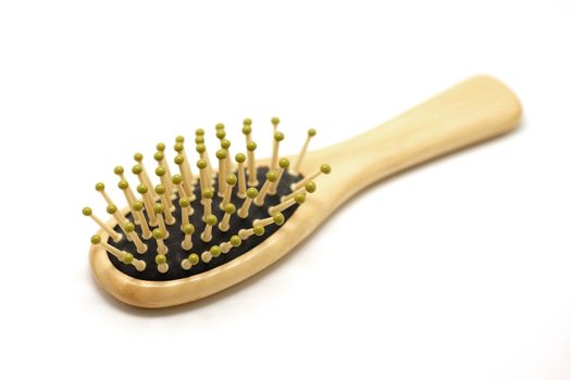 wooden comb on white background