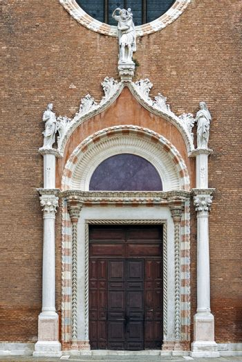 Decorated gothic church doors in Venice, Italy