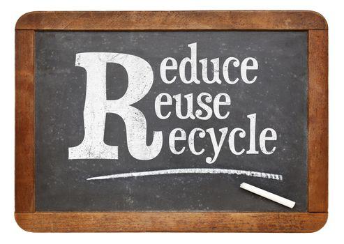 Reduce, reuse, recycle blackboard sign - white chalk text on a vintage slate blackboard