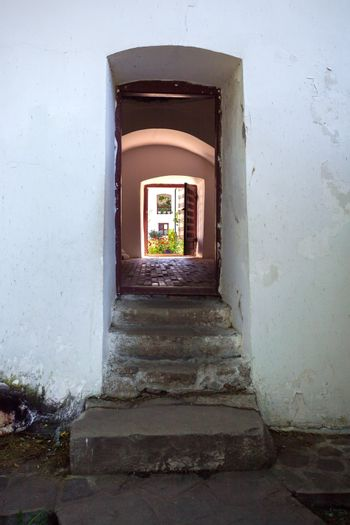 Cozia, Romania - Septemper 2, 2012: Doorway connecting the courtyards of  Cozia monastery housing the tomb of Mircea the Elder, Romania