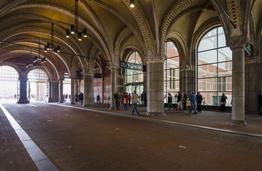 Amsterdam, Netherlands - May 6, 2015: People at main entrance of the Rijksmuseum passage