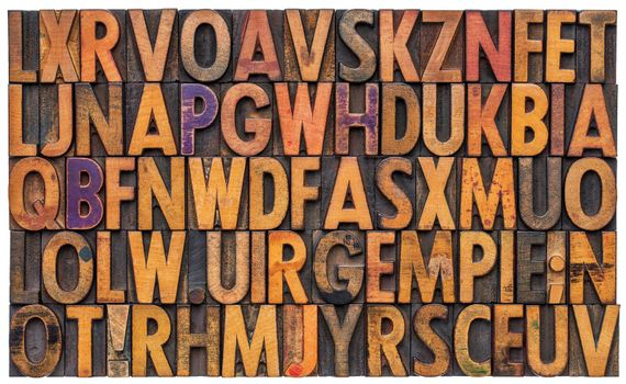 background of vintage letterpress wood type printing blocks, random letters of alphabet and punctuation stained by color inks, isolated on white