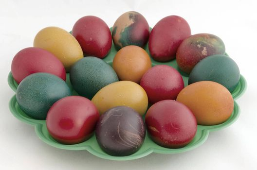 Painted Easter eggs in the green plate