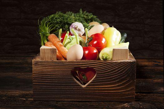Seasonal vegetable in wooden box.