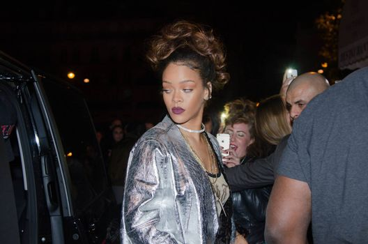 FRANCE, Paris : In France for the Paris Fashion Week, star singer Rihanna enters a club, near the Champs-Elys�es, in Paris, on the night between October 1st and October 2, 2015.