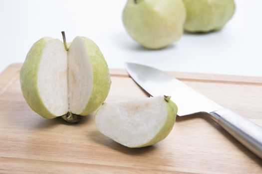 Fresh guava with knife isolated