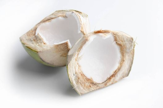 Half green coconut isolated on white