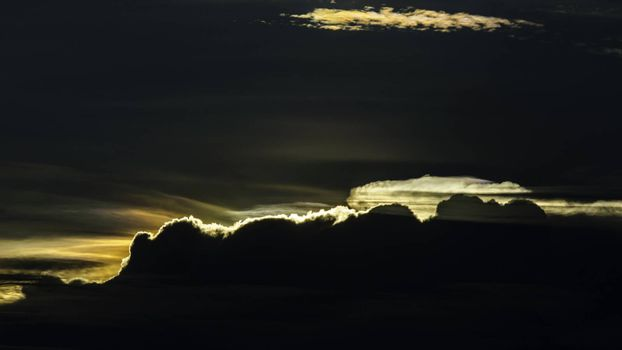Silhouette of cloud with Iridescence on sunset sky background