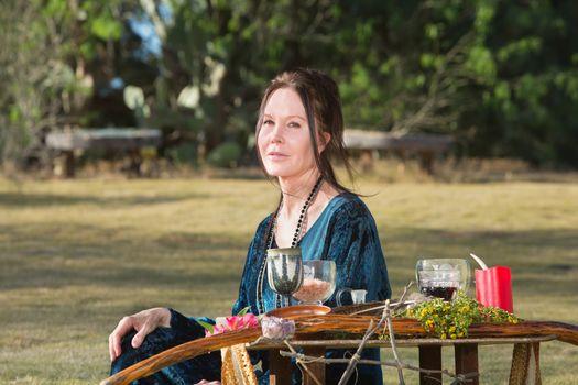 Pagan Woman Sitting Outdoors