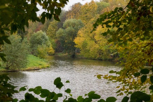 The photo depicts the landscape of the autumn pond