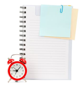 Copybook with stickers and alarm clock