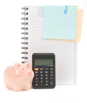 Copybook with piggy bank and calculator