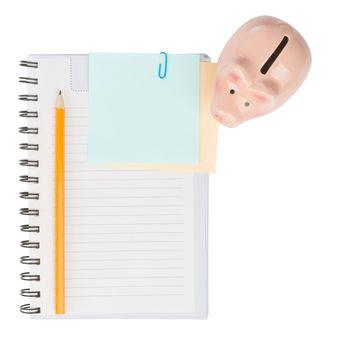 Copybook with piggy bank, top view