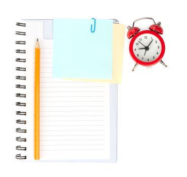 Copybook with alarm clock, top view