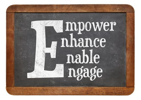 Empower, enhance, enable, engage word abstract - white chalk text on a vintage slate blackboard