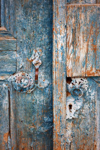 Close-up view on the old door with rusty metal details