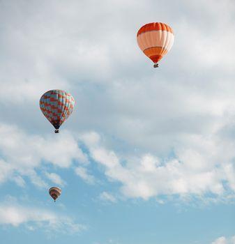 Three air balloons  in blue sky. Vertical photo