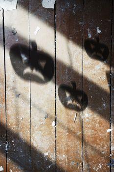 Shadow of Halloween pumpkin on the wooden wall