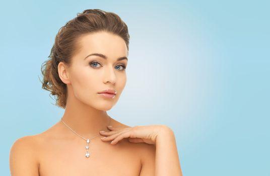 beautiful woman wearing shiny diamond pendant
