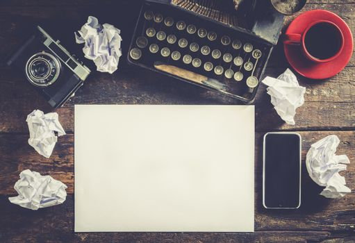 Typewriter and blank paper