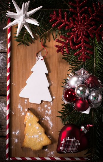 Christmas decoration on old wooden board with blank space in the middle