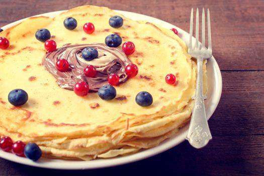 Sweet pancakes and fruit