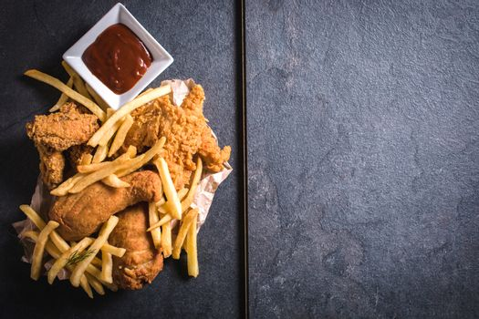 Chicken meat and french fries