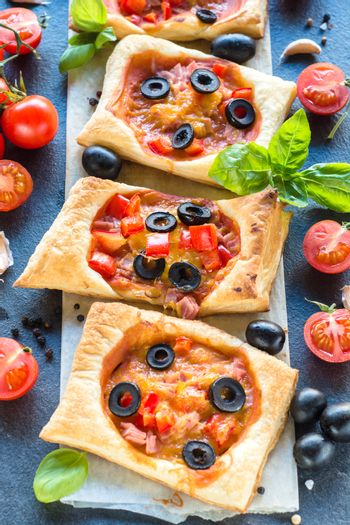 Mini pizza with ham and vegetables,selectve focus in the middle