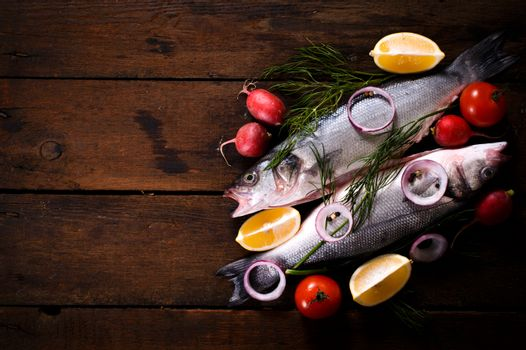 Fresh bass fish on wooden background