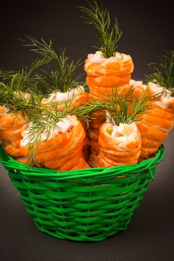 Easter stuffed carrots pastry in the basket,selective focus