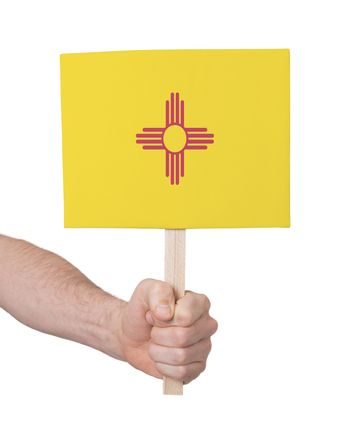 Hand holding small card - Flag of New Mexico