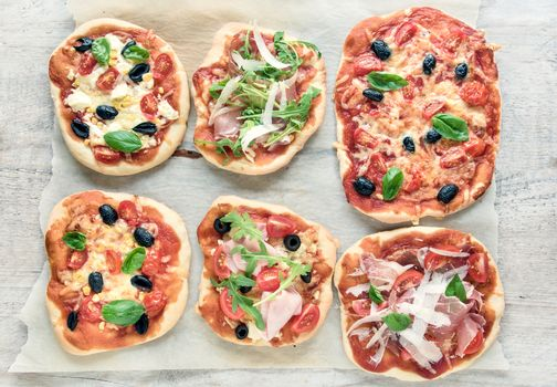 variety of small pizzas