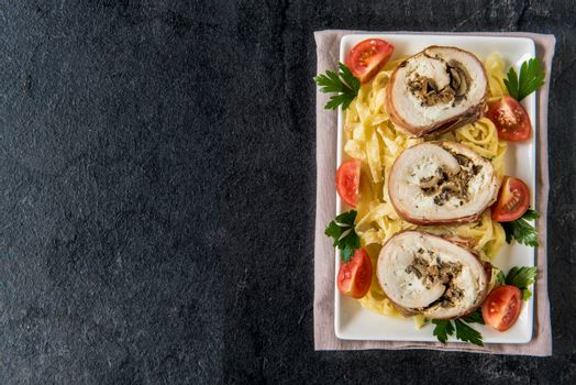 Rolled meat with champignons and cheese