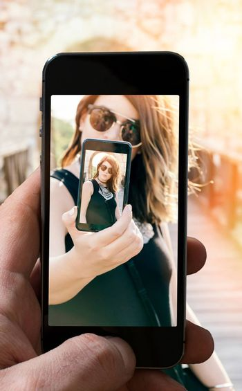 Selfie concept with beautiful woman,selective focus