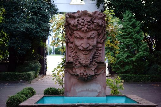 Mainz, Germany - September 19, 2015: A fountain with a sculpture of Bacchus in the courtyard of the Kupferberg terraces on September 19, 2015 in Mainz.