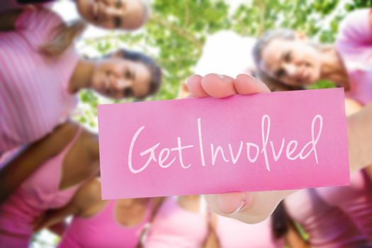 Get involved against smiling women in pink for breast cancer awareness
