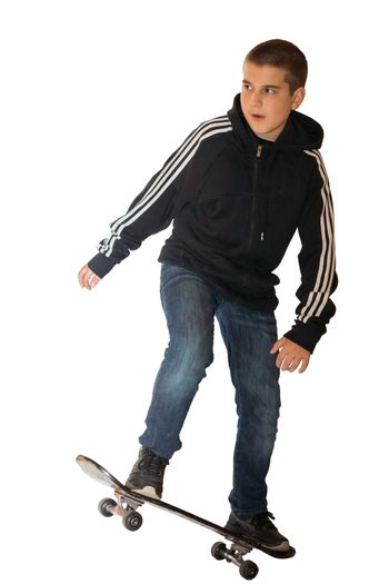 The photo depicts a boy on a skateboard