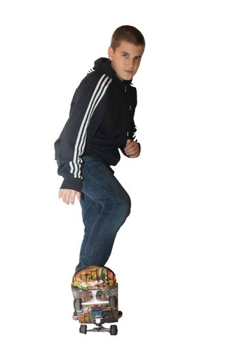 the photograph depicts a boy on a skateboard