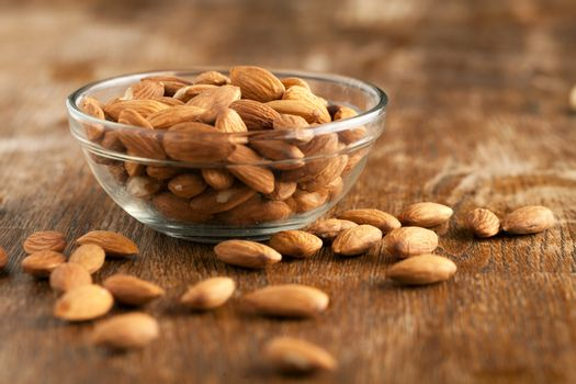 Organic almonds in raw form unroasted and unsalted.  Close up macro still life with a shallow depth of field.