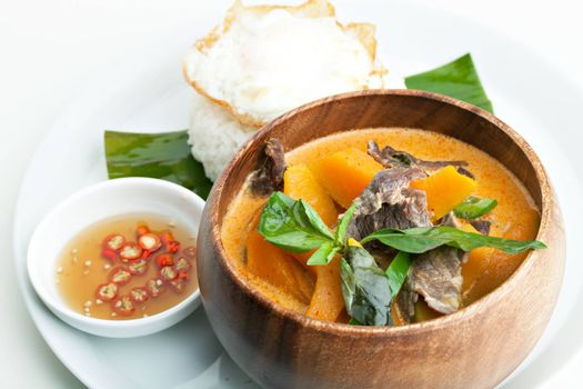 Pumpkin red curry with beef and basil.