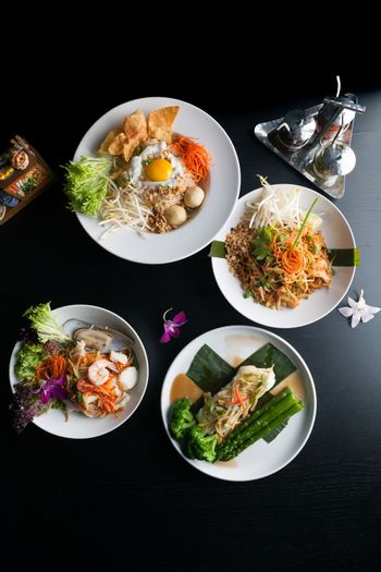 Variety of authentic Thai cuisine and stir fry dishes.  Shallow depth of field.