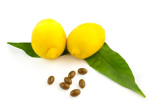 detail of pills and a lemon with leaves