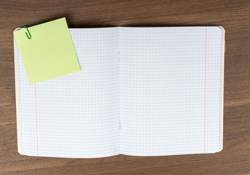Open copybook on table