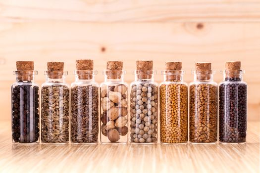 Assorted of spice bottles condiment  black pepper ,white pepper,
