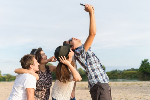 Group Of Young Adult Friends Taking Selfie