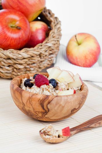 Healthy bowl of muesli, apple, fruit and milk for a nutritious b