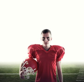Composite image of a serious american football player looking at camera