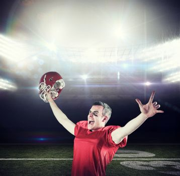 Composite image of a triumph of an american football player without his helmet