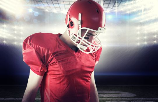 Composite image of a football player taking his helmet on her head